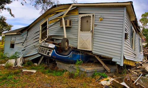 Photo of a house destroyed by a weather disaster.